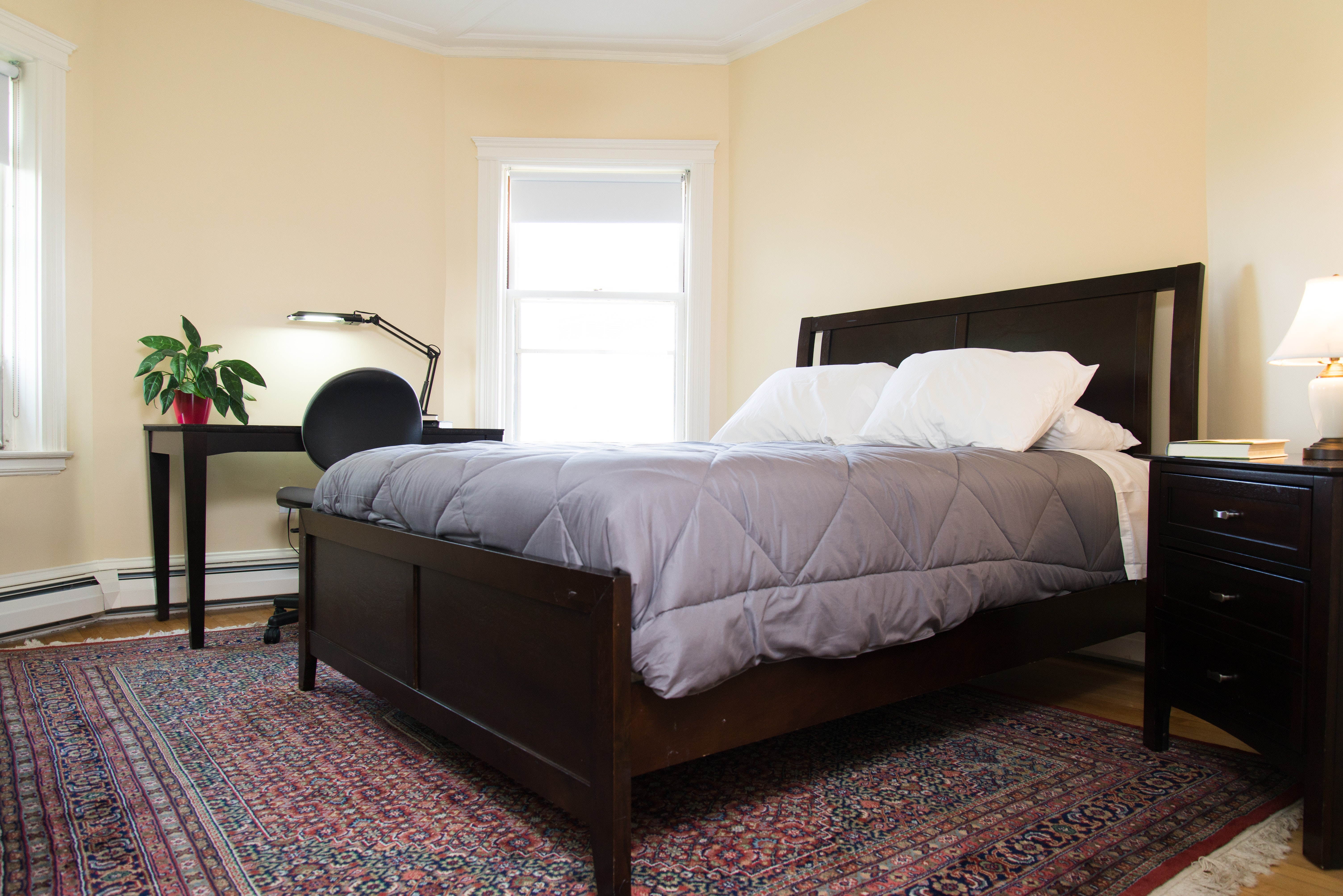 Bedroom with furnishings in 83 Brattle Street one bedroom with hallway apartment