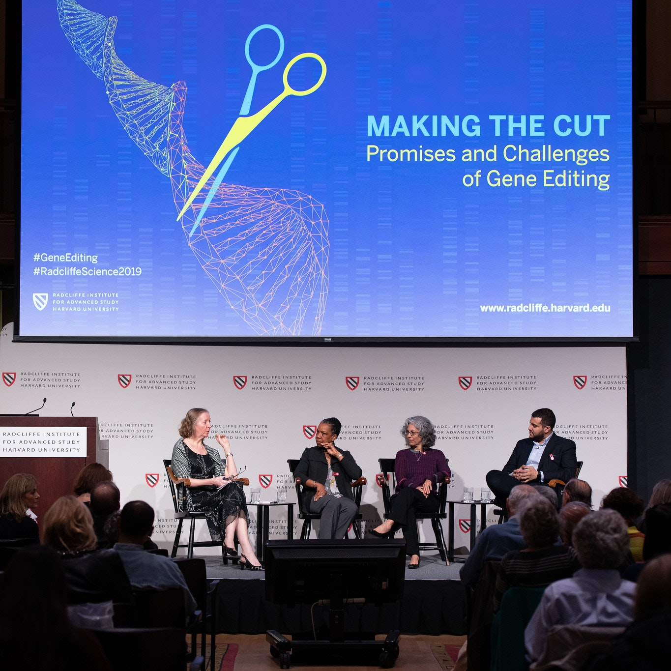 "Group of four people seated on stage with presentation slides for ""Making the Cut"""