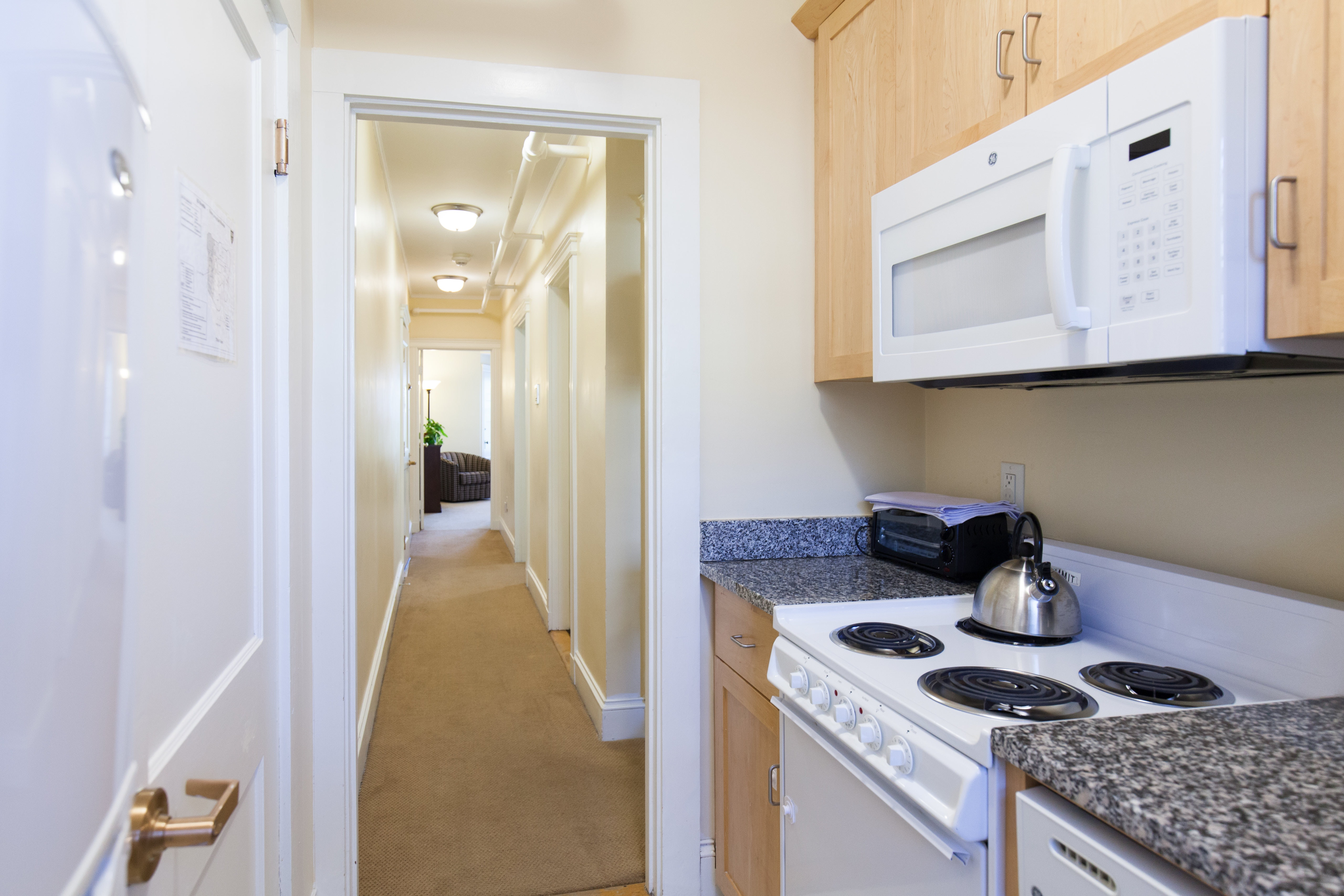 Kitchen and hallway in 83 Brattle Street two bedroom apartment