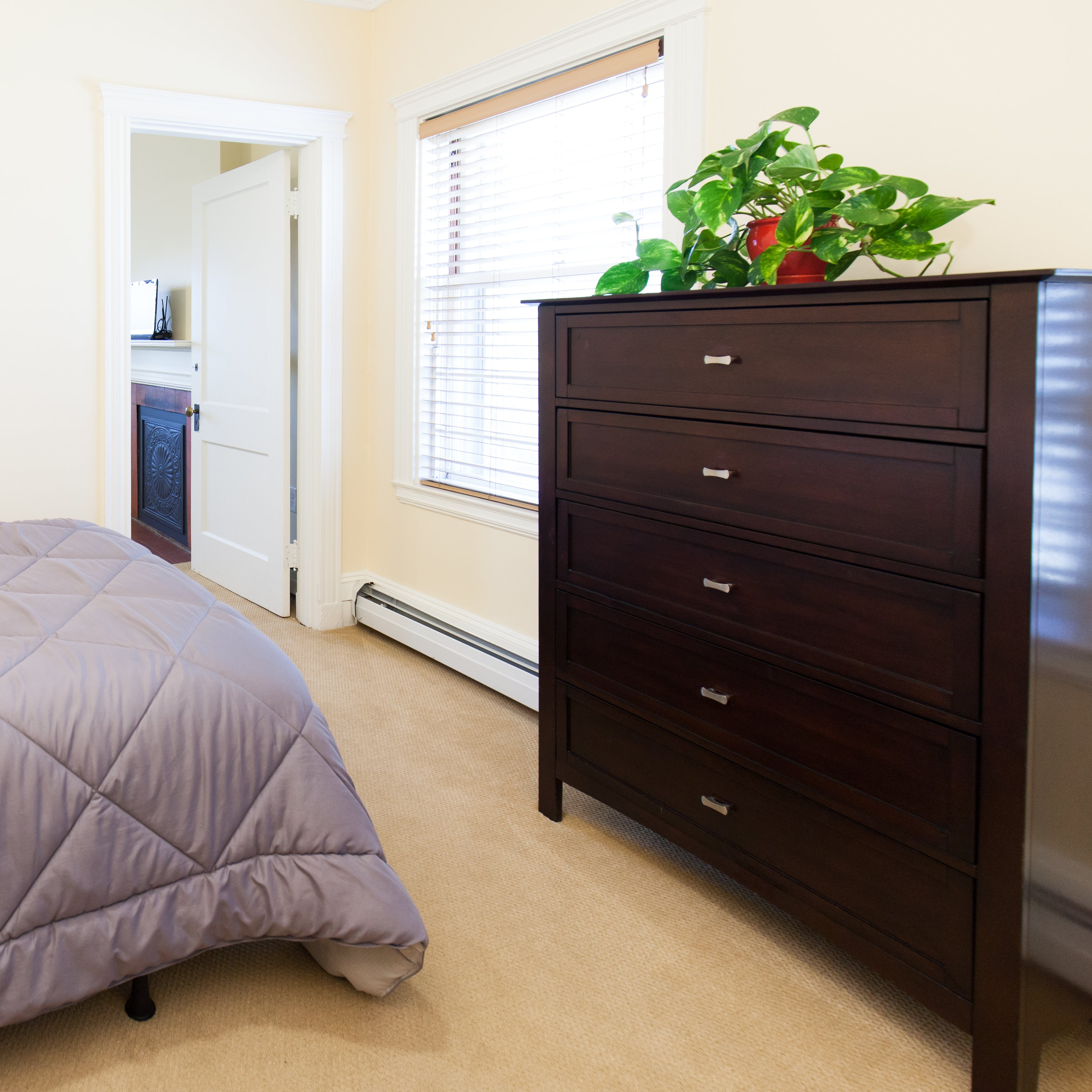 Second bedroom with furnishings in 83 Brattle Street two bedroom apartment