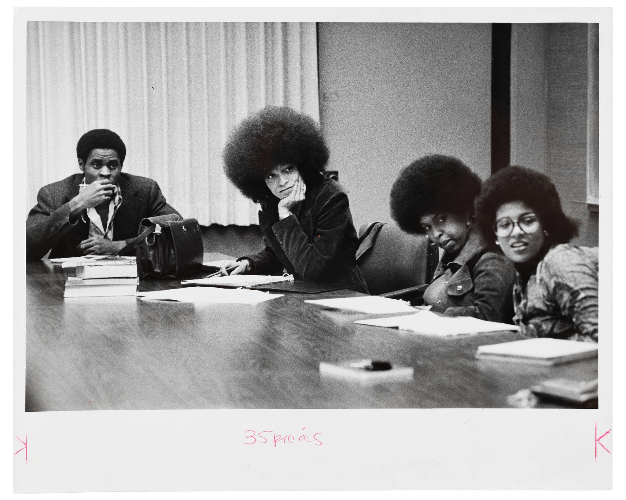Angela Davis sitting in class with 3 others.