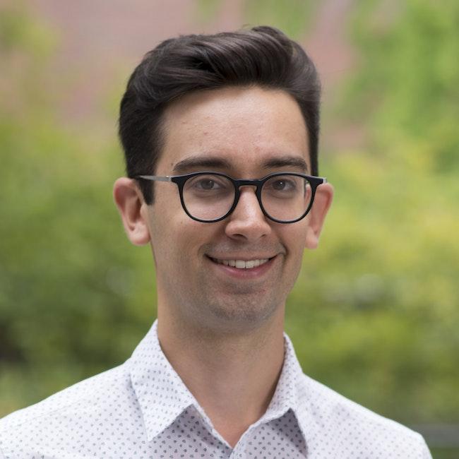 Headshot of Adam Tanaka
