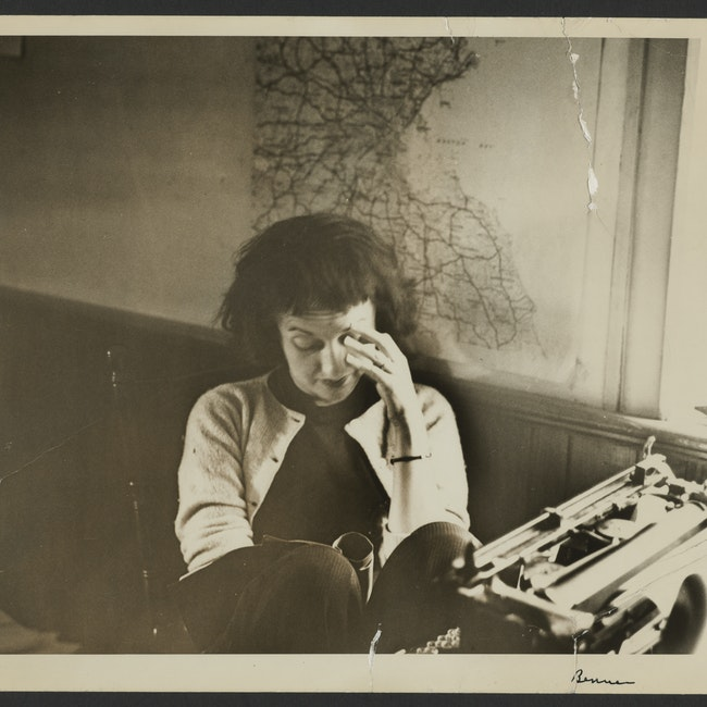 Portrait of Betty Friedan working at a desk with a typewriter