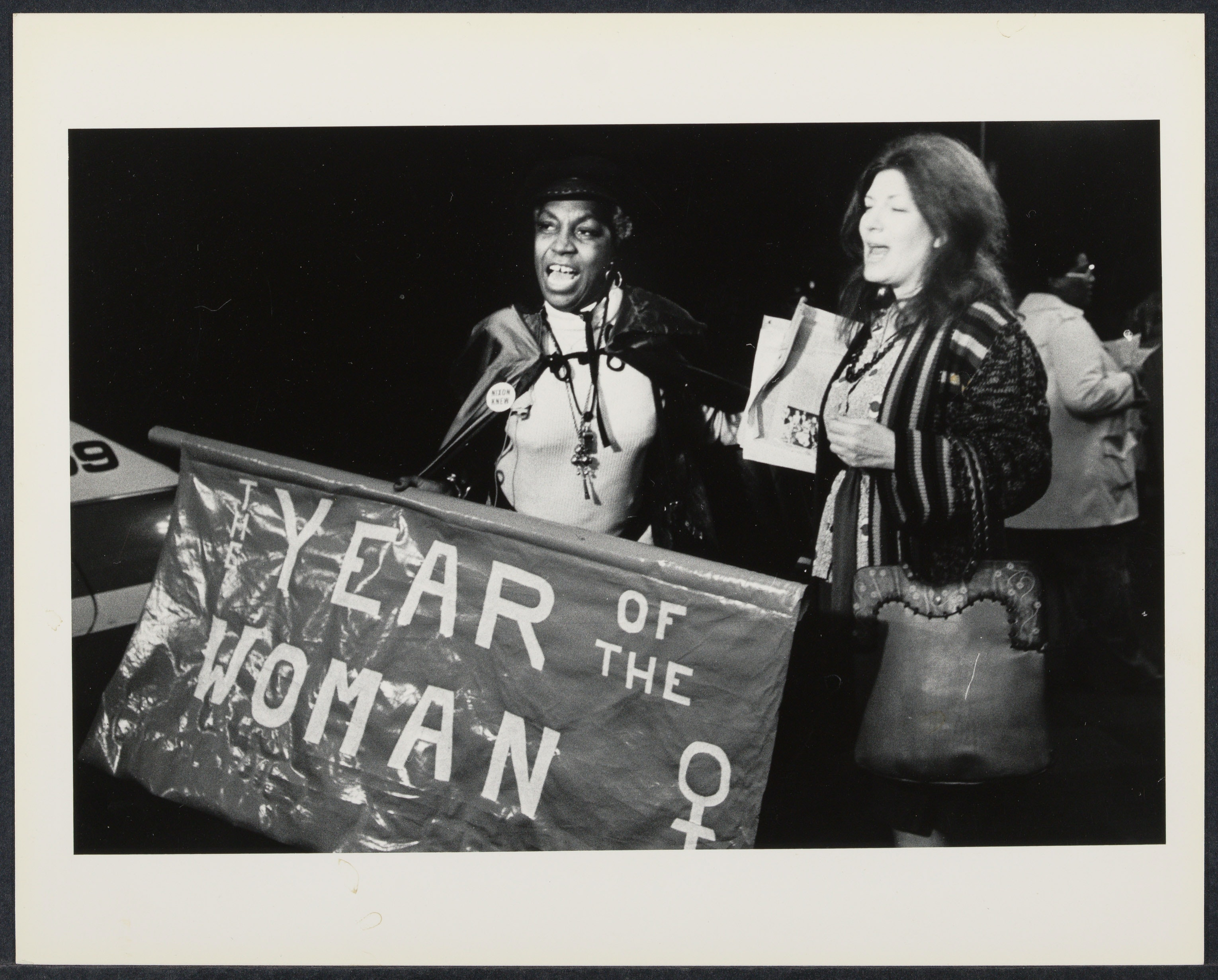 "Banner states, ""Year of the Woman"" with Flo Kennedy and an unidentified woman"