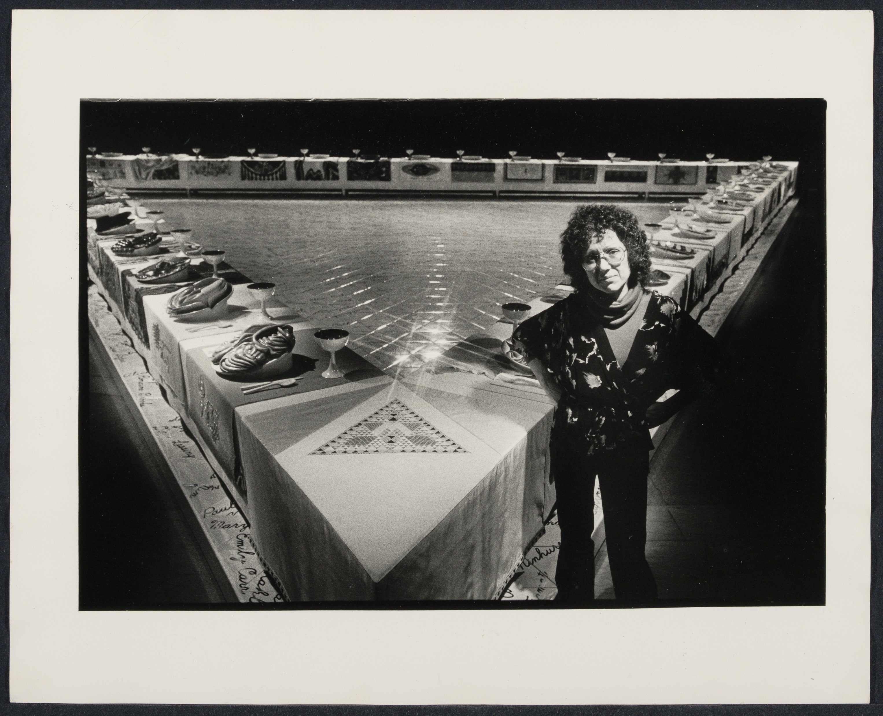 "Artist Judy Chicago with ""The Dinner Party"""