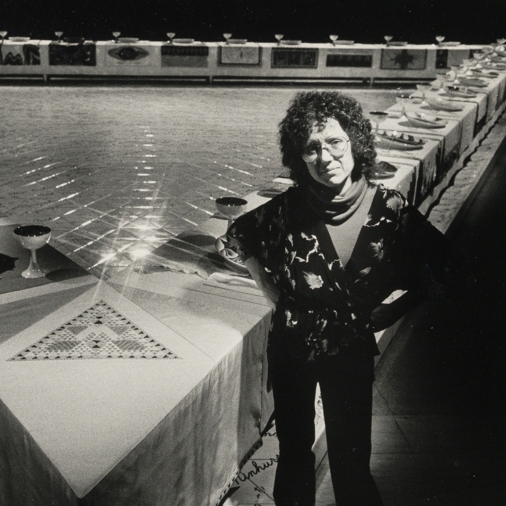 """Artist Judy Chicago stands in front of her work """"The Dinner Party"""""""