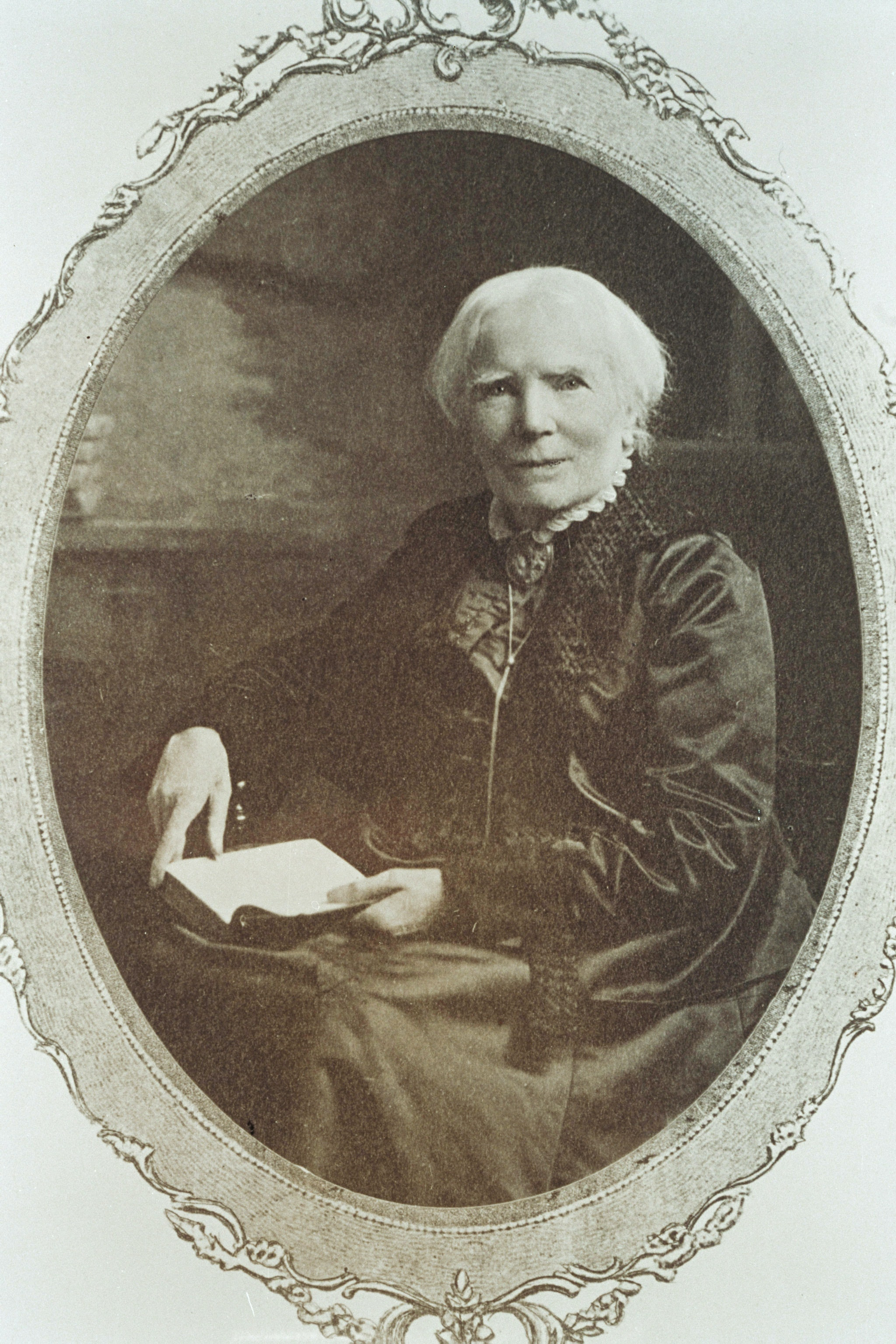 Elizabeth Blackwell seated with an open book on her lap