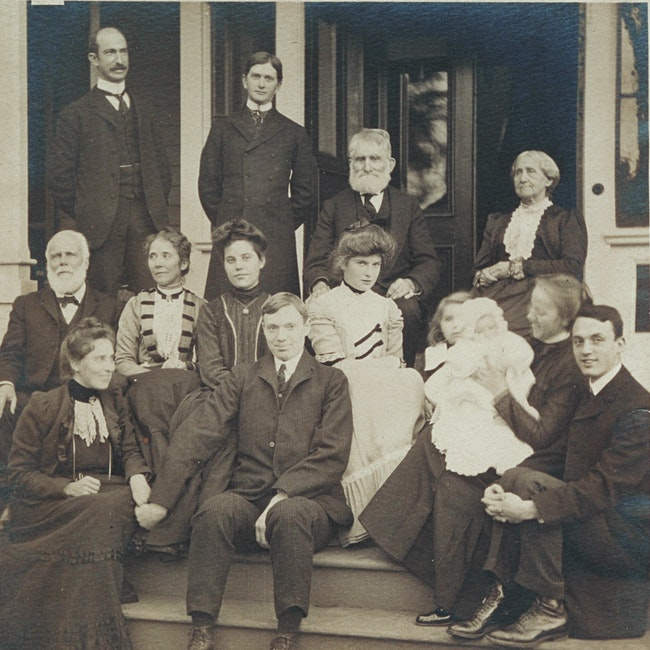 Group portrait of members of the Blackwell family on a dwelling porch