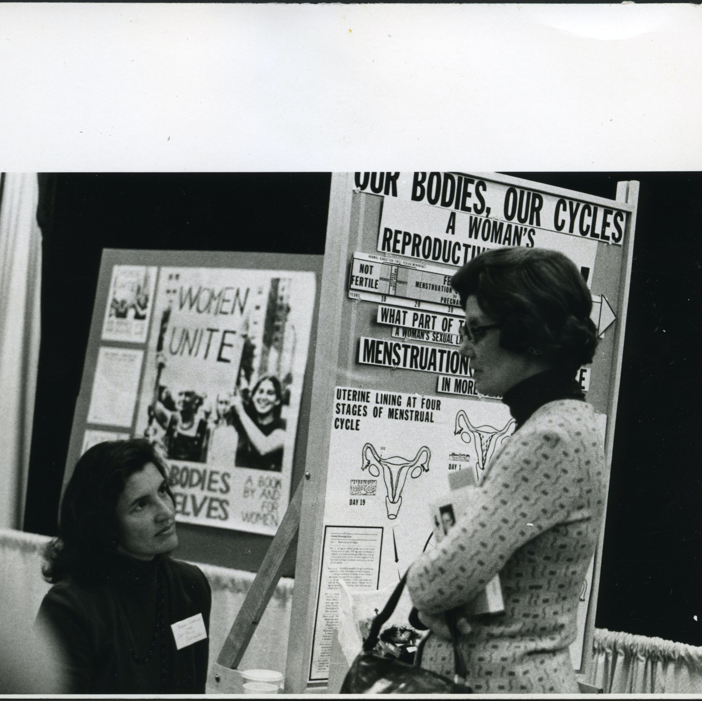Norma Swenson and Betsy Cole at exhibit booth for Our Bodies, Ourselves