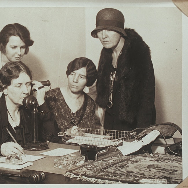 Anna Wiley telephoning Doris Stevens accompanied by other women