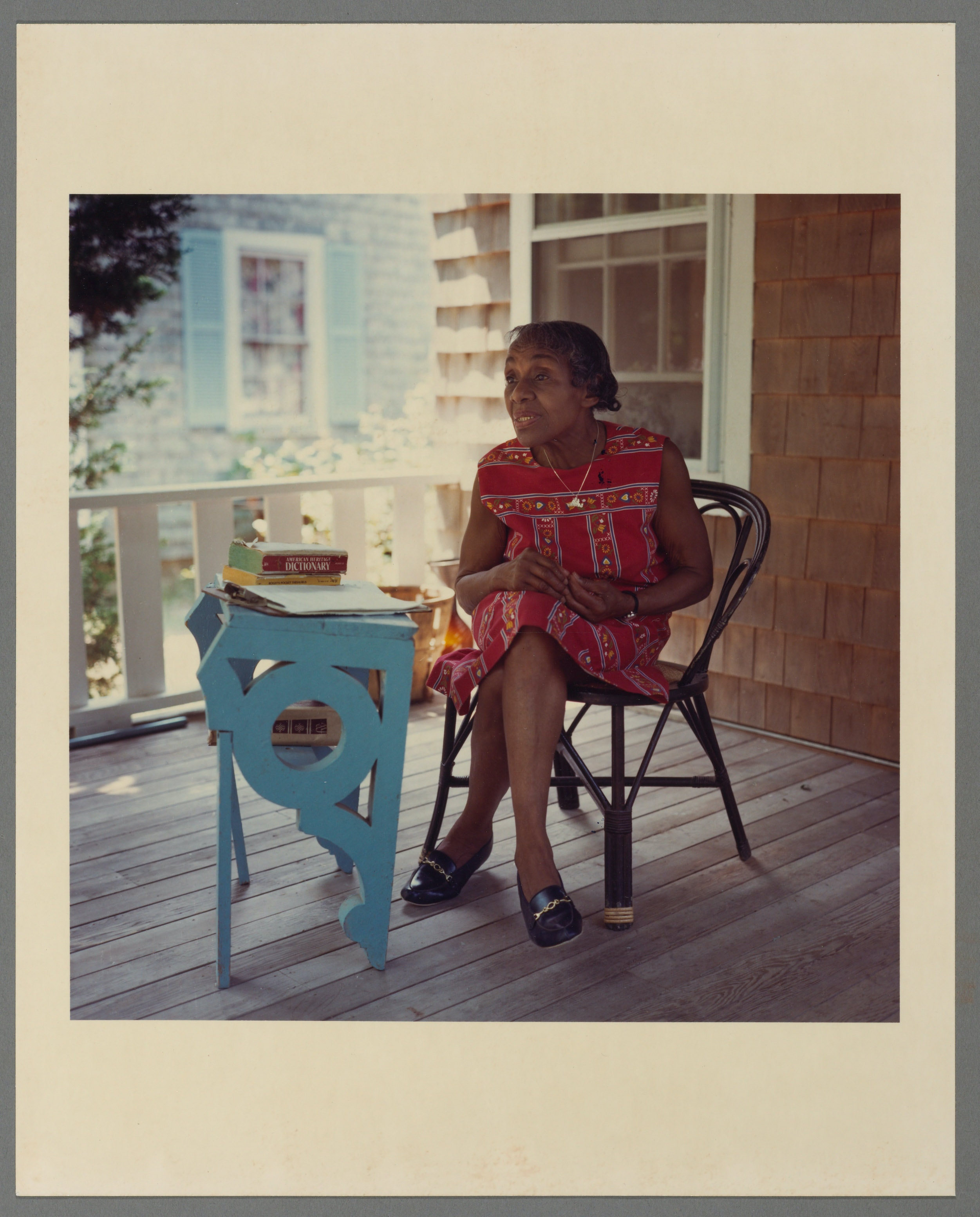 Portrait of Dorothy West seated at her writing desk