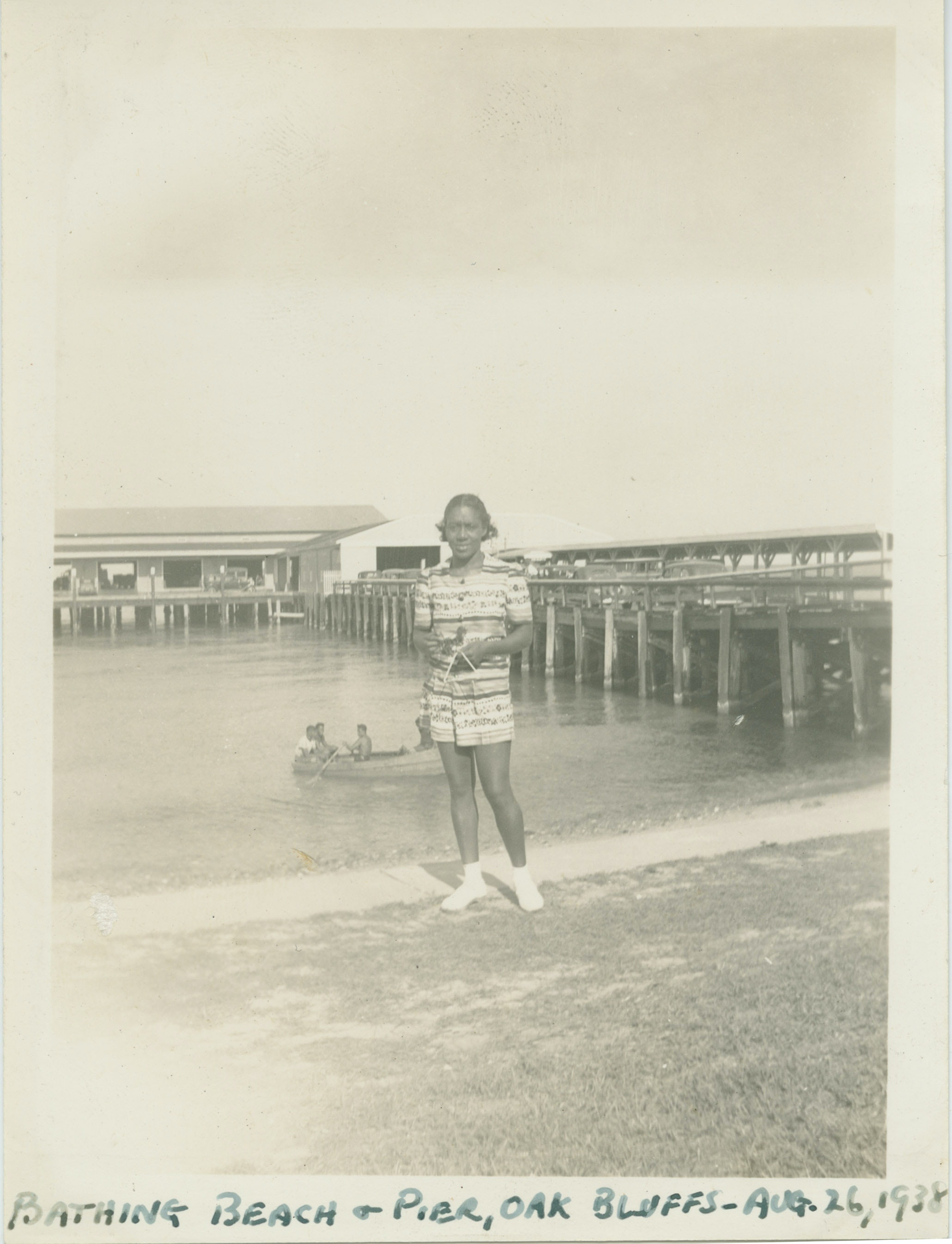 Dorothy West standing in front of a pier at Oak Bluffs beach on Martha's Vineyard