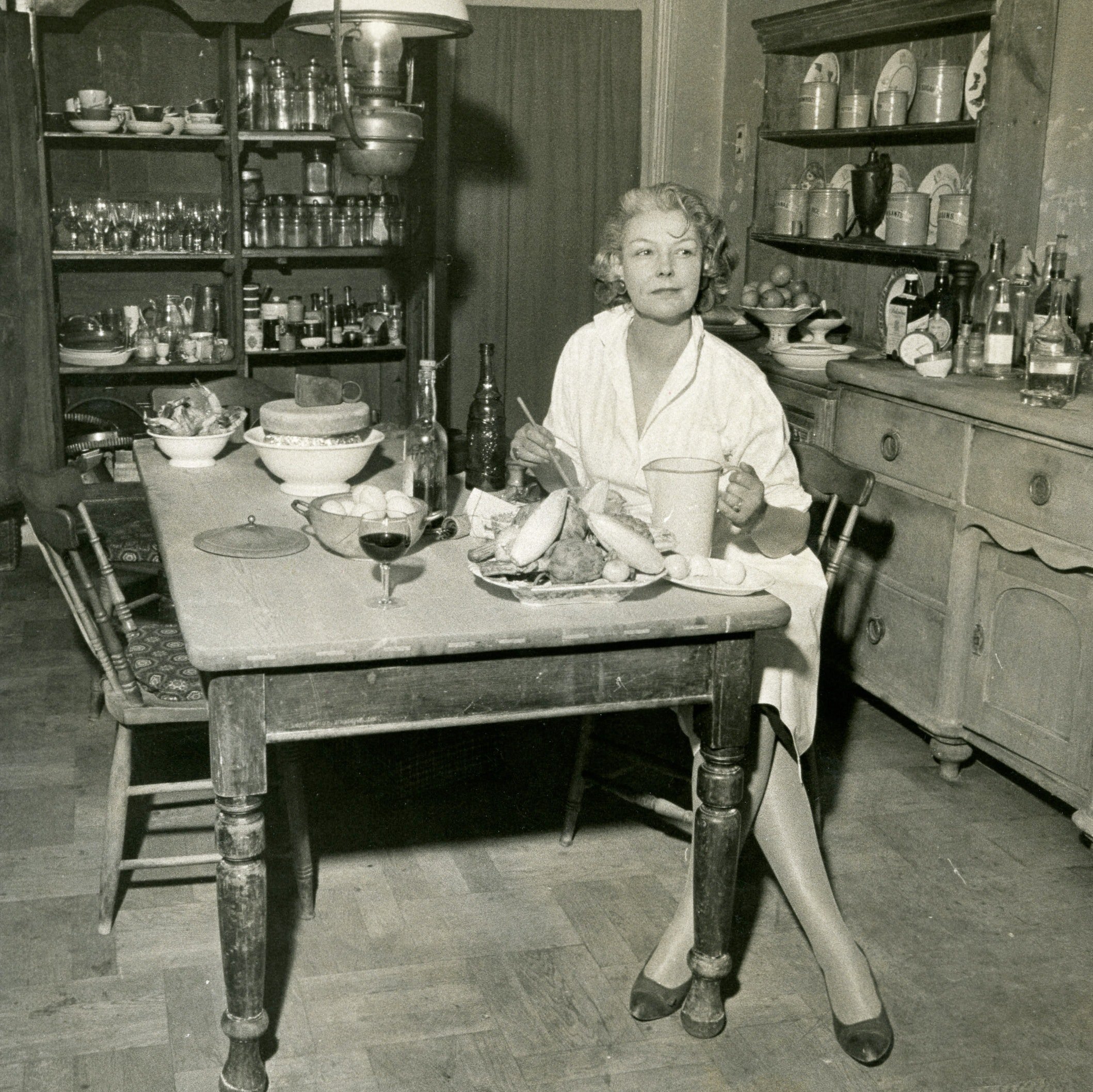 Elizabeth David sitting at the table in her kitchen