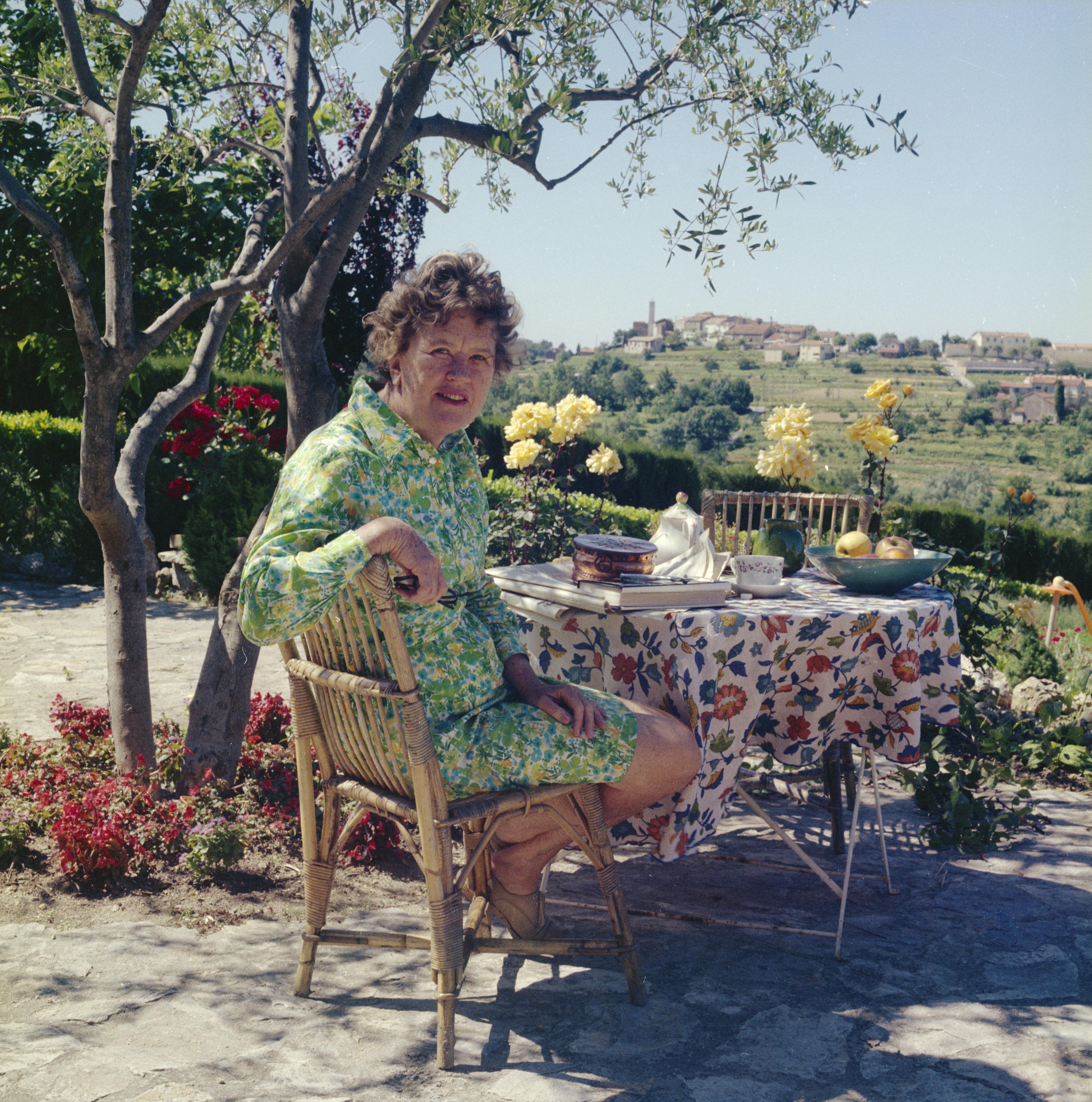 Julia Child having breakfast in the terrace