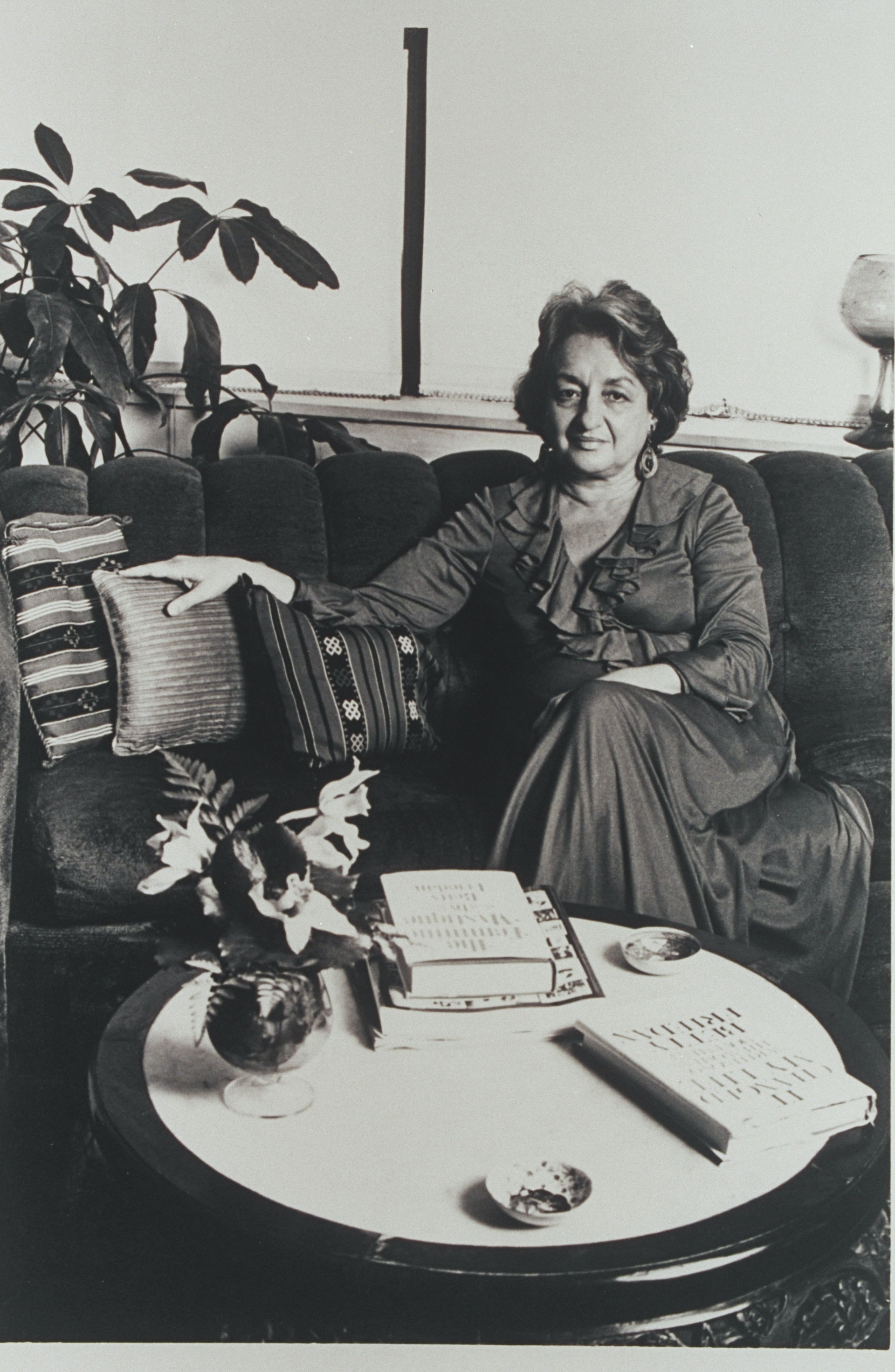 Betty Friedan, seated with copies of her book