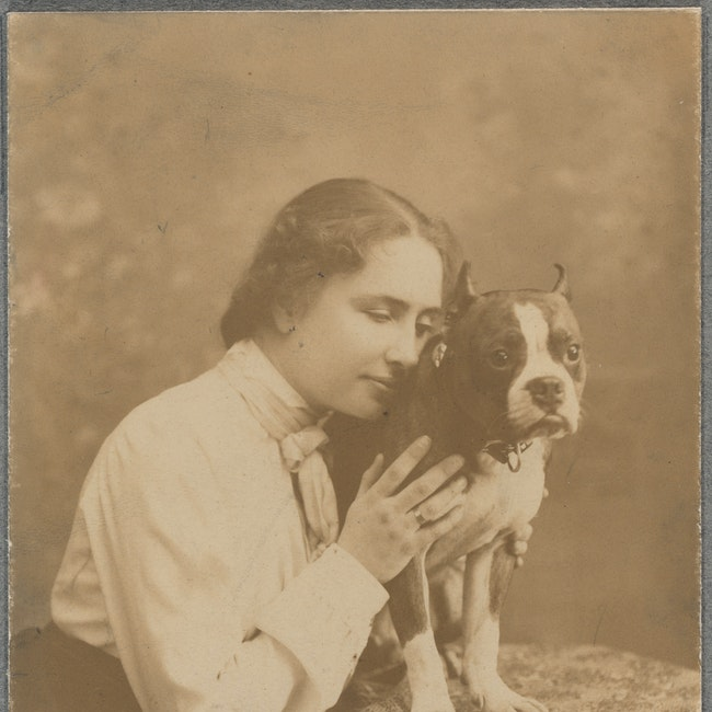 Helen Keller posing with her dog
