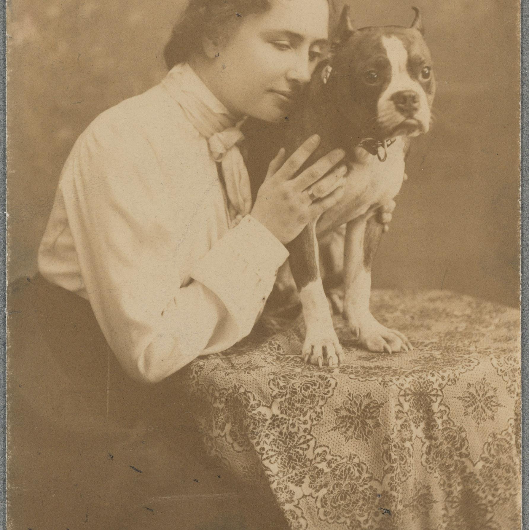 Helen Keller posing with her dog
