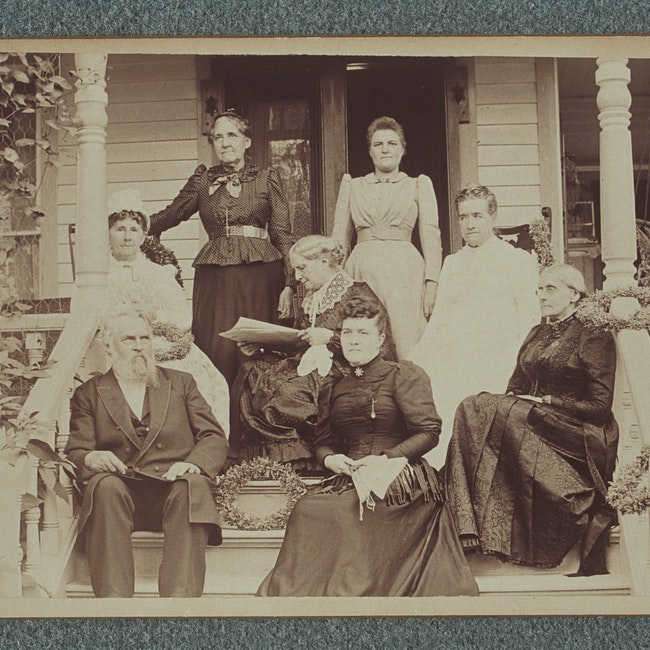 Susan B. Anthony and others, possibly members of the Anthony family, on porch