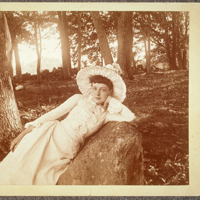 Maud Wood laying on rock, outdoors