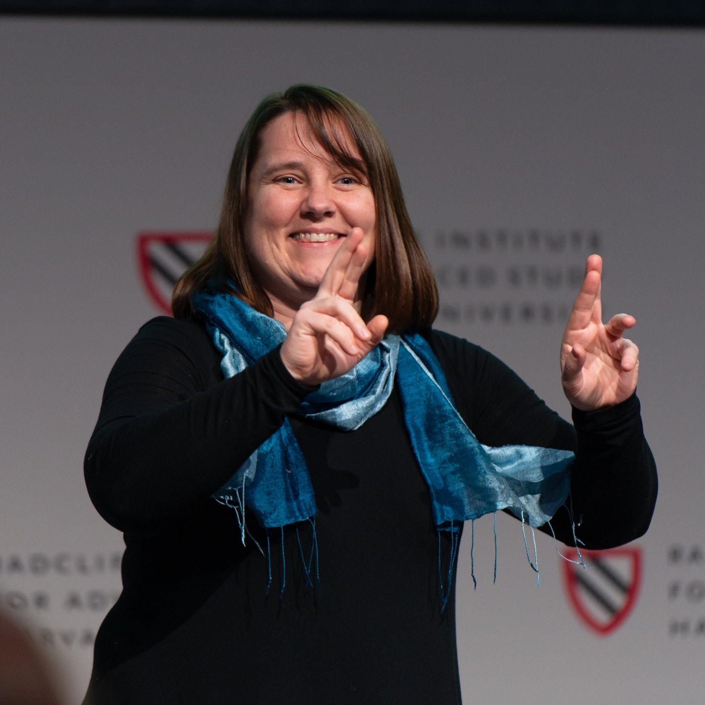 """Amy Szarkowski giving a speech at the """"Beyond Words"""" conference"""