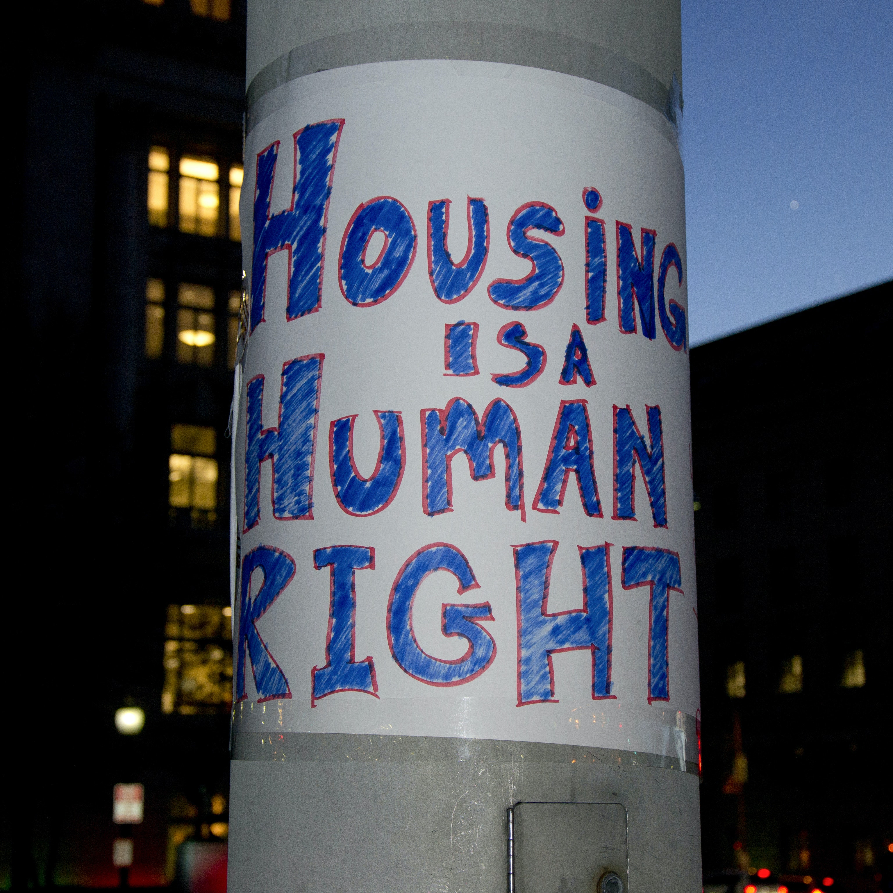 "Protest sign that reads, ""Housing is a human right"" seen in Washington D.C. during a rally for equal housing opportunities."
