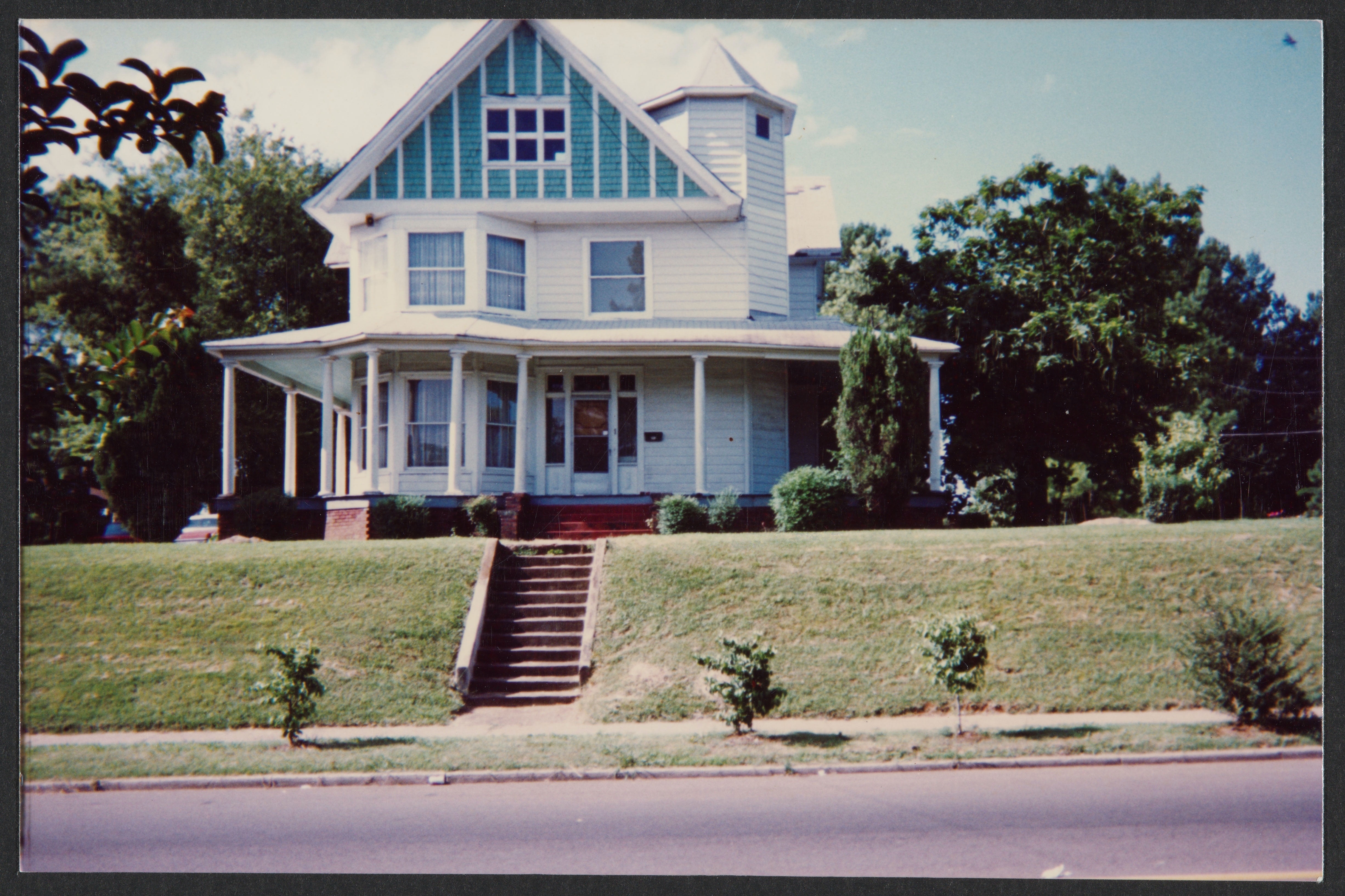 Front view of a blue family home.