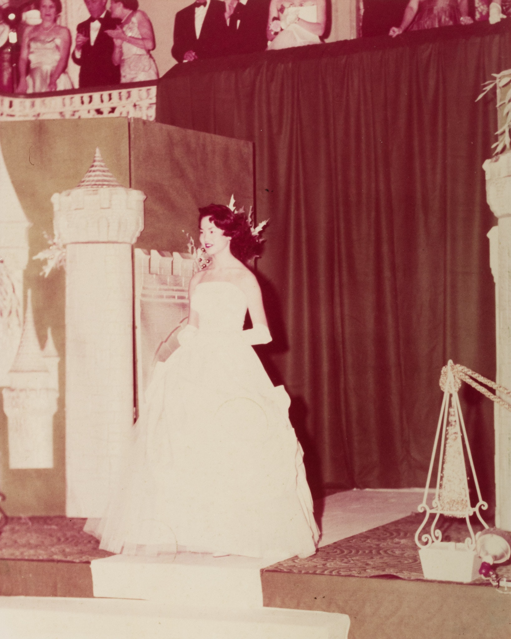 Sepia toned image of Alice in long white gown