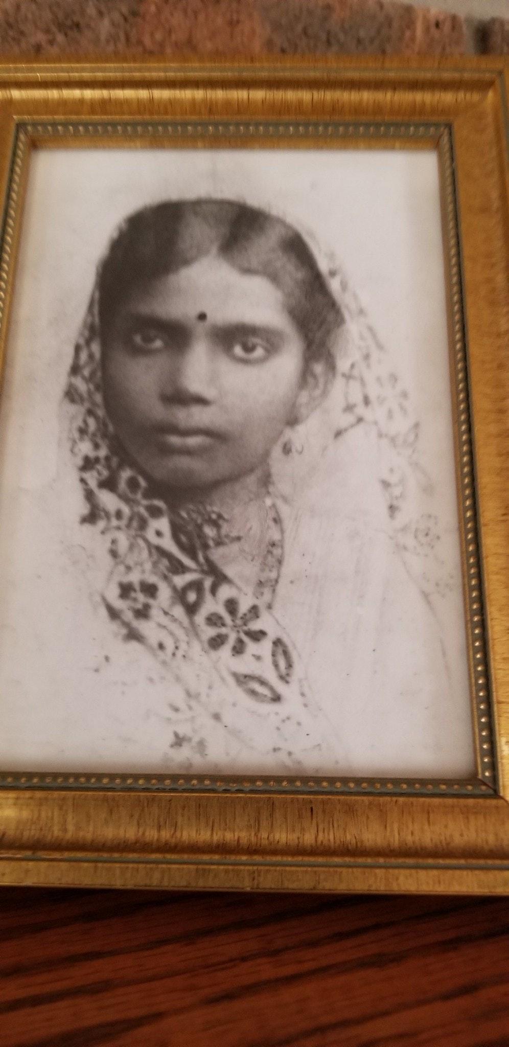 Black & White photo with gold frame of Manisha Sinha's grandmother, Radha Sinha