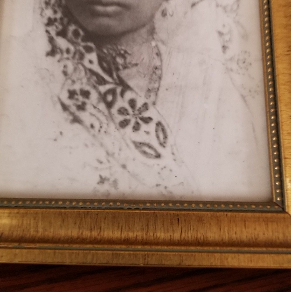 Black & White photo with gold frame of Manisha Sinha's grandmother, Radha Sinha