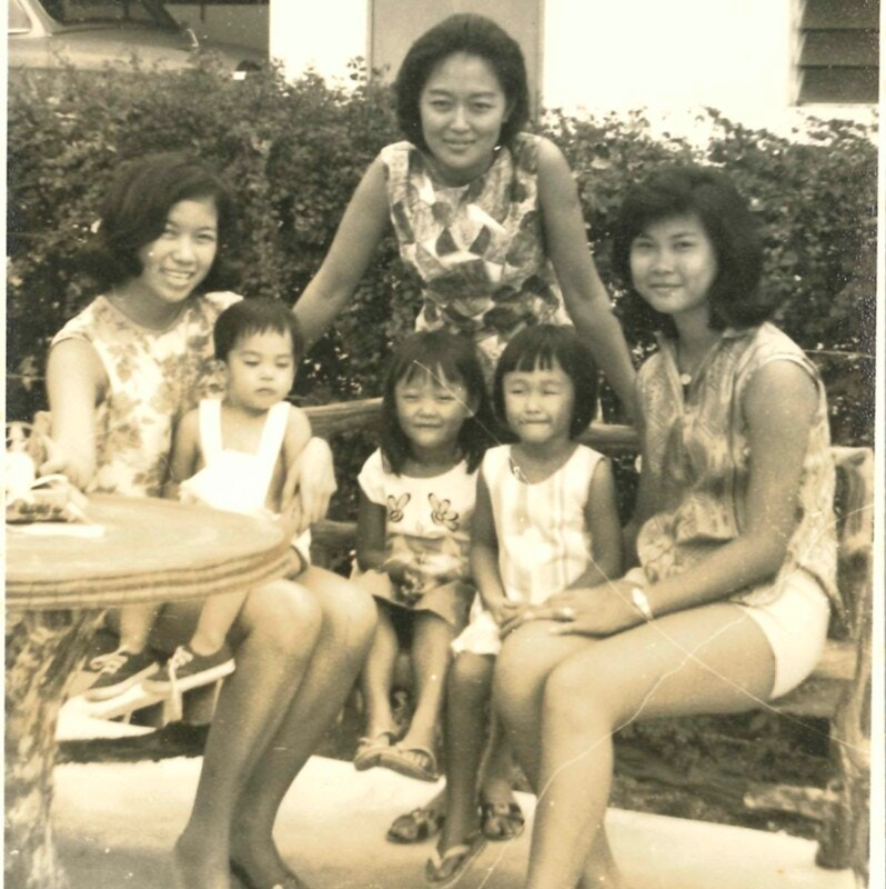 Sepia toned image of  Sharon Bromberg-Lim with family and friends in backyard