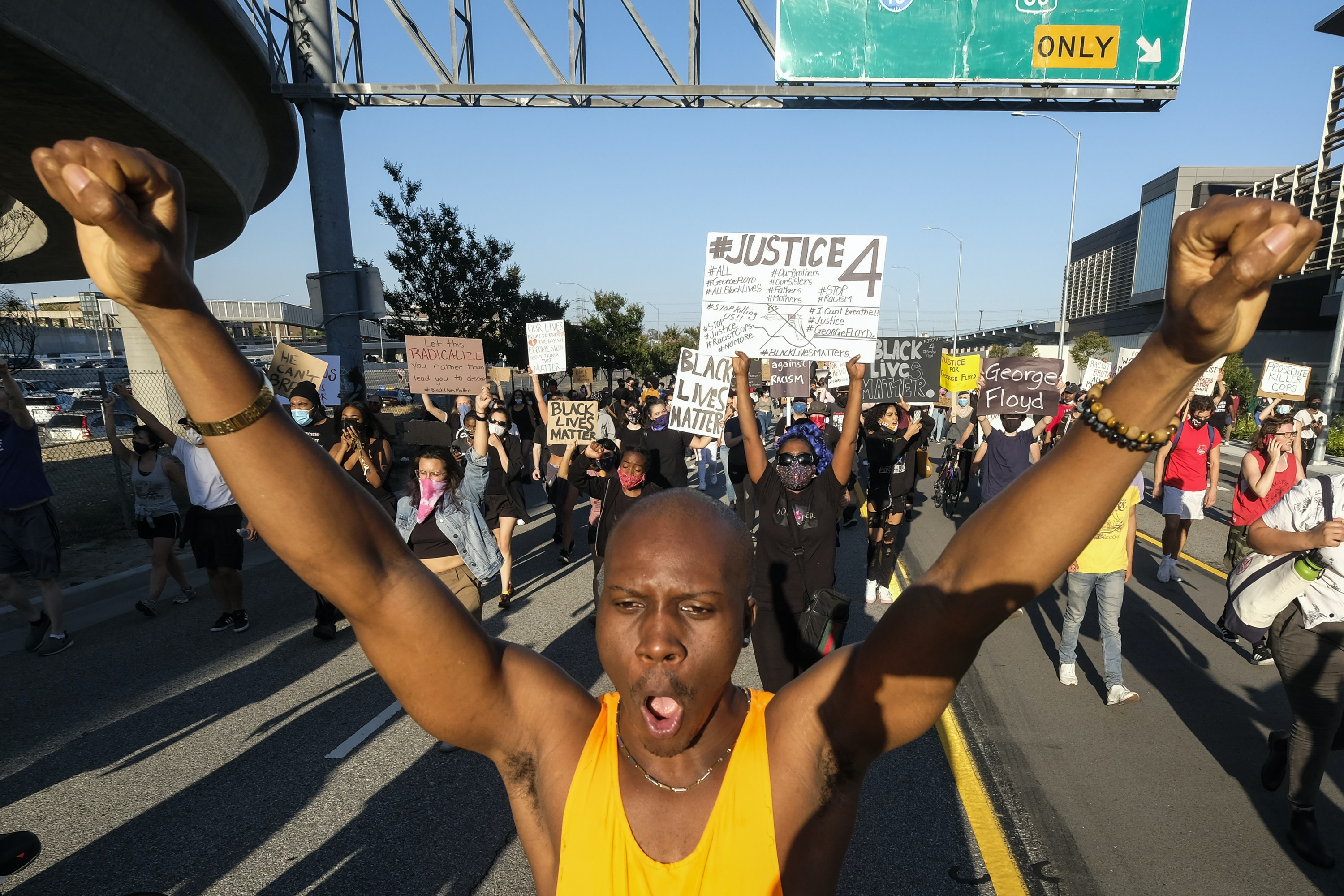 Demonstrators marched in Los Angeles following the police killing of George Floyd in Minneapolis. AP Photo/Ringo H.W. Chiu