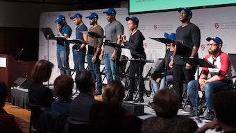 "The actors Cheo Bourne, Jason Bowen, Ugo Chukwu, Taavon Gamble, Nambi E. Kelley, Omar Robinson, Kyle Vincent Terry, and Joe Wilson Jr. perform on stage in ""Game Changer: Toni Stone."""