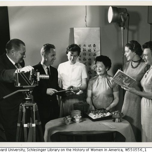 Black and white image of Grace Chu and others with camera and lighting