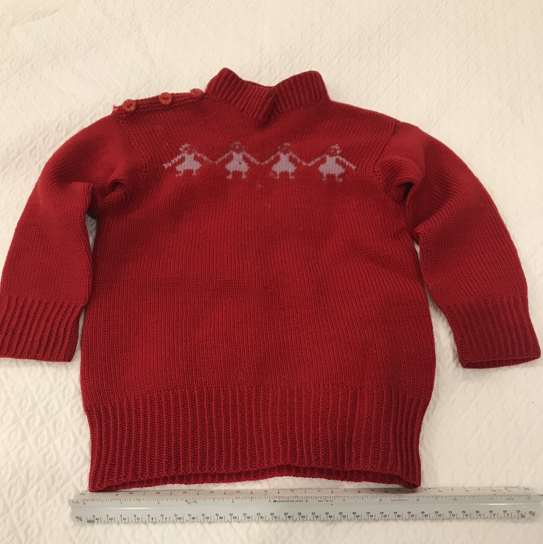 Toddler sized red knit sweater with 4 girls holding hands