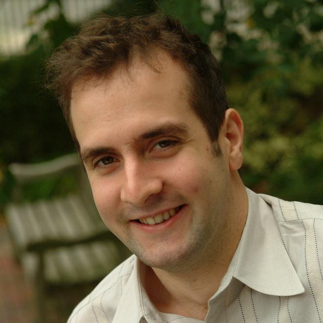 Headshot of Tarik O'Regan