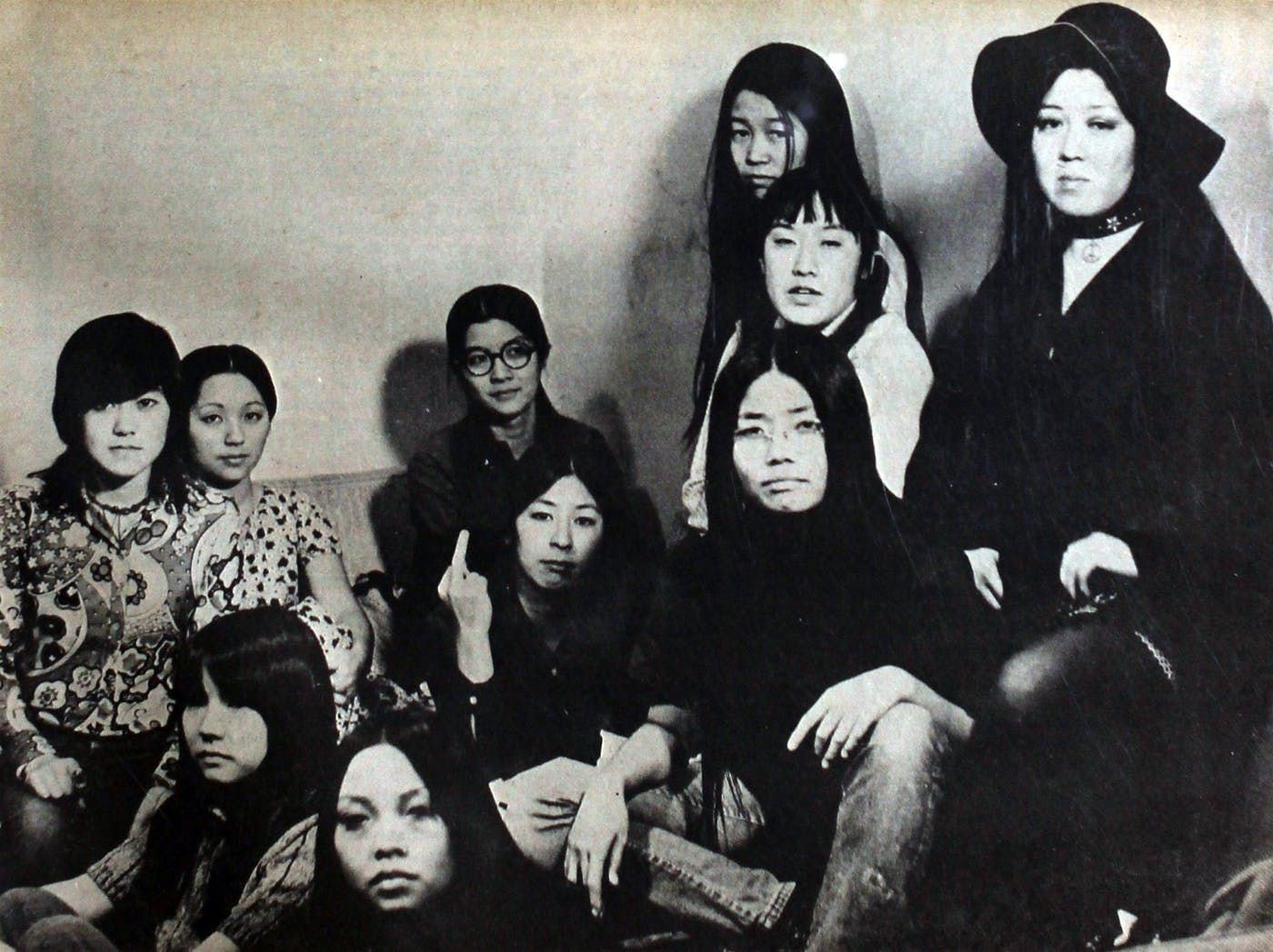 Black and white image of Asian American activists seated around