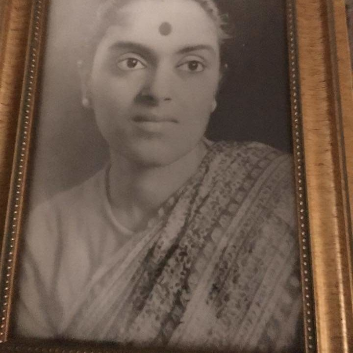 Black and white portrait with gold frame of Sinha Manishas's mother