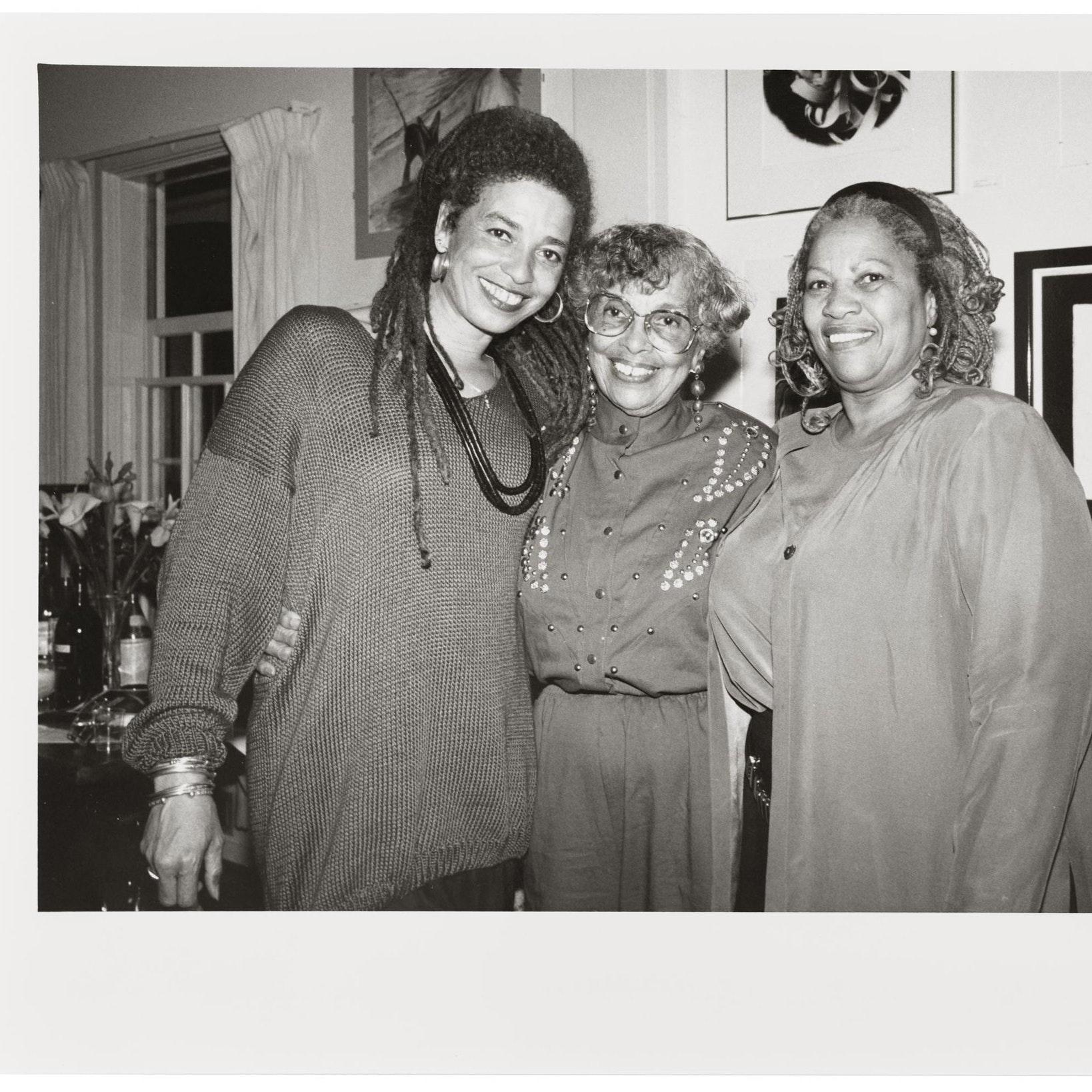 Black & white photograph of Toni Morrison, Sallye Davis, and Angela Davis.