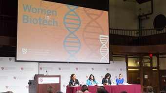 "Panel discussing solutions and strategies at the ""Women in Bioetch"" symposium."