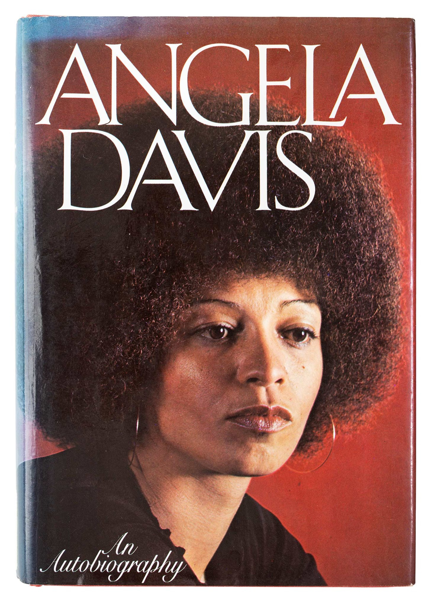 Headshot of Angela Davis with red backdrop.