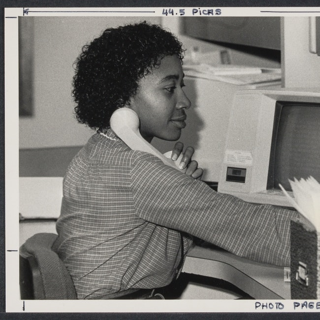 Office worker on the phone and working in an office