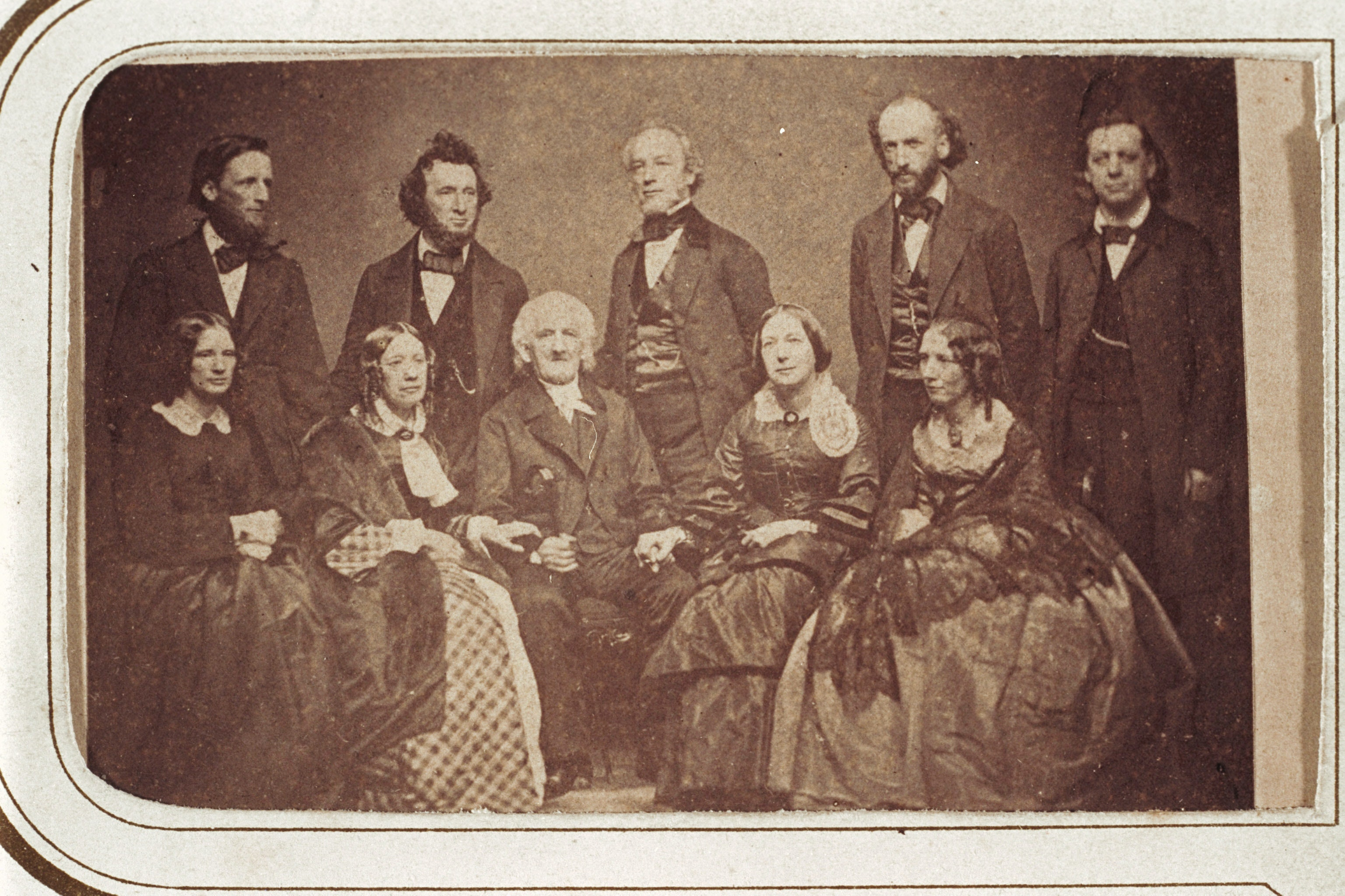 Group portrait of the Beecher family. Standing from left to right Thomas, William, Edward, Charles, Henry Ward, and seated from left to right, Isabella, Catherine, Lyman, Mary, and Harriet
