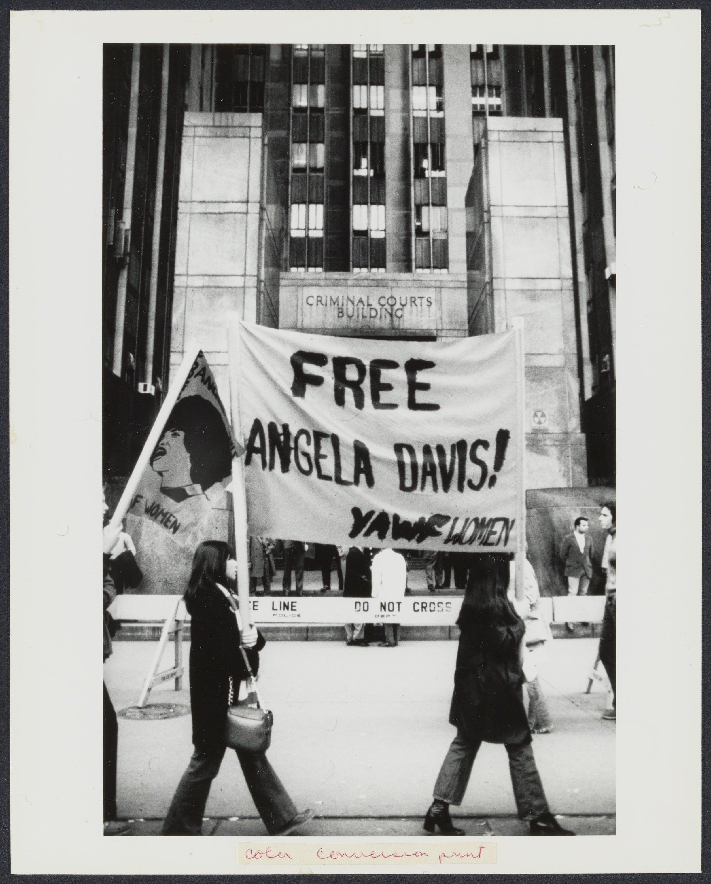 "Women holding a ""Free Angela Davis"" banner"