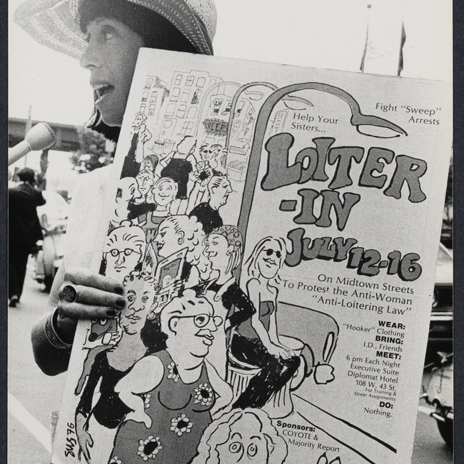 Margo St. James holding a poster as she protests outside the Democratic National Convention