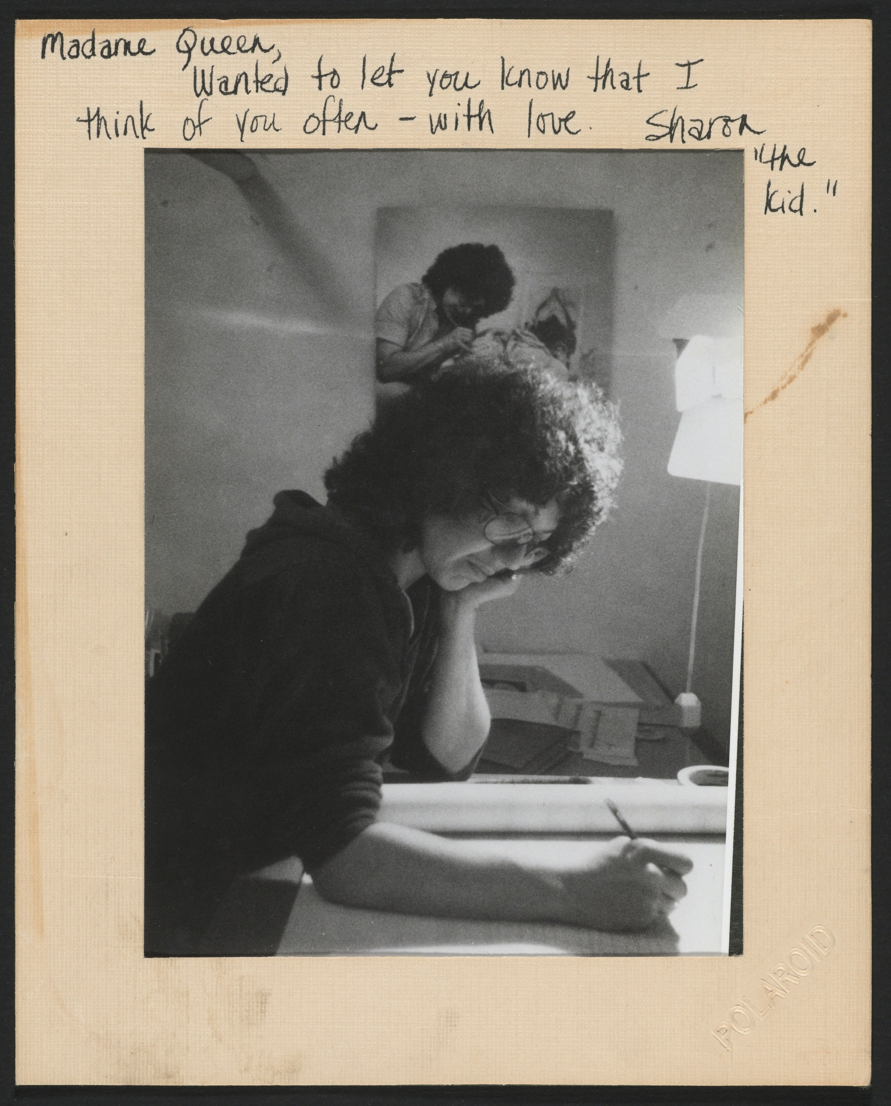 Judy Chicago writing at her desk
