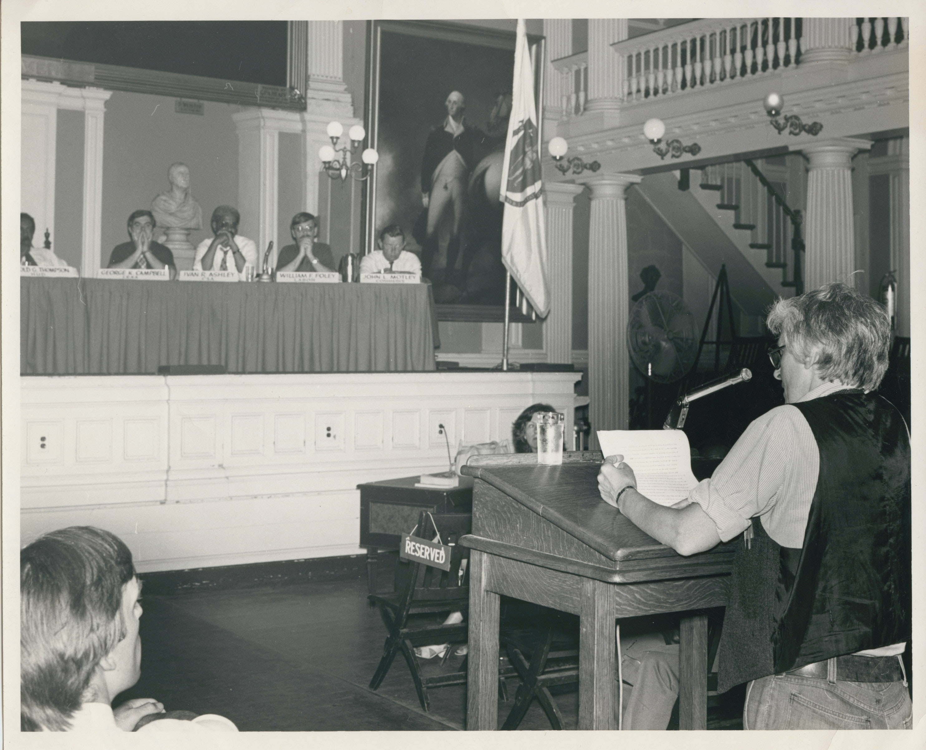 Kip Tierman giving a testimony in the Great Hall at Faneuil Hall, ca. 1975.