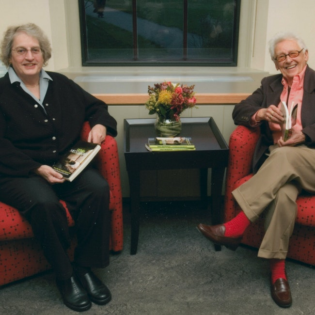 Kip Tiernan and Fran Froehlich sitting in red chairs at Schlesinger Library