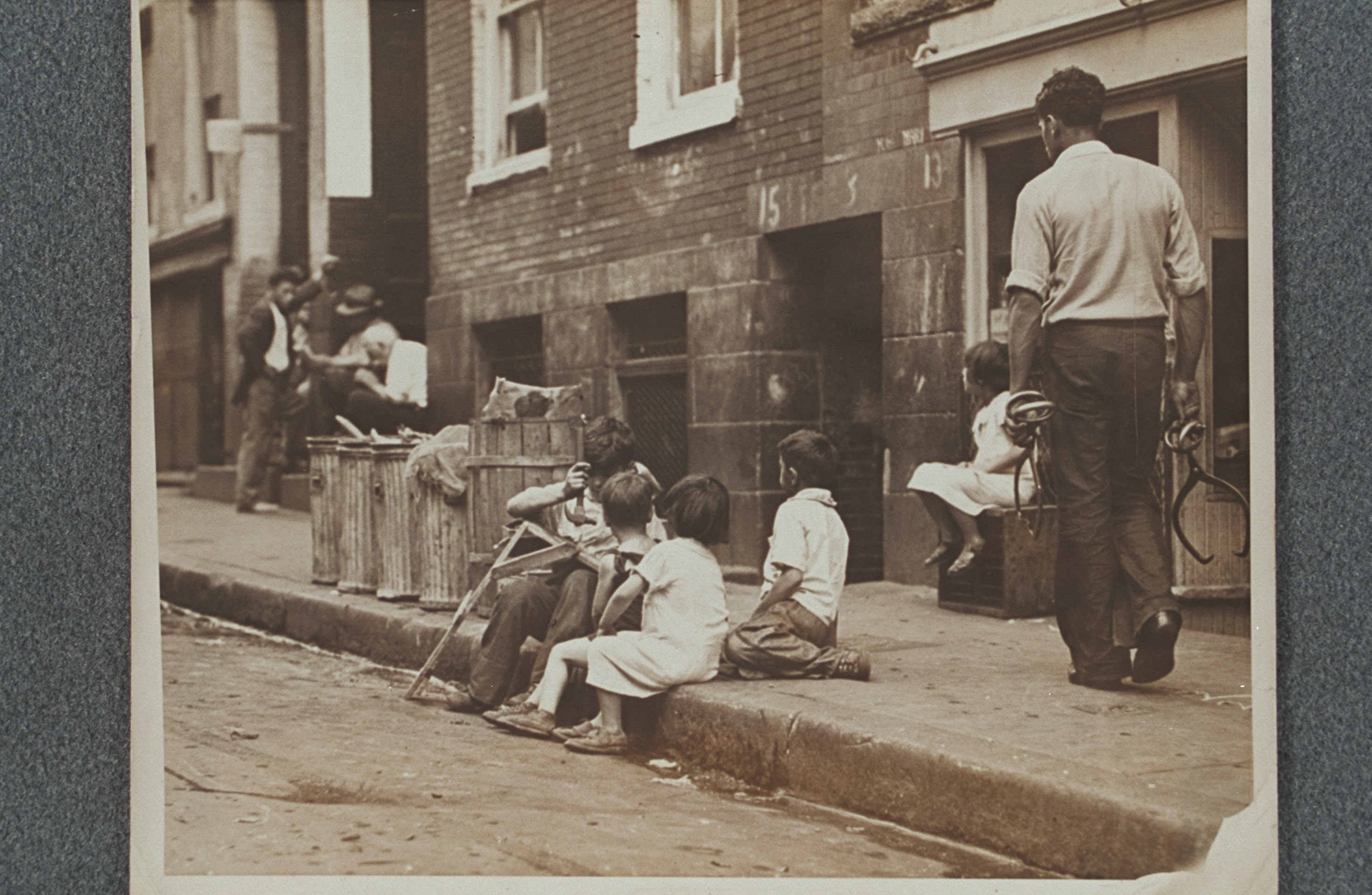 5 children playing on the streets in the North End