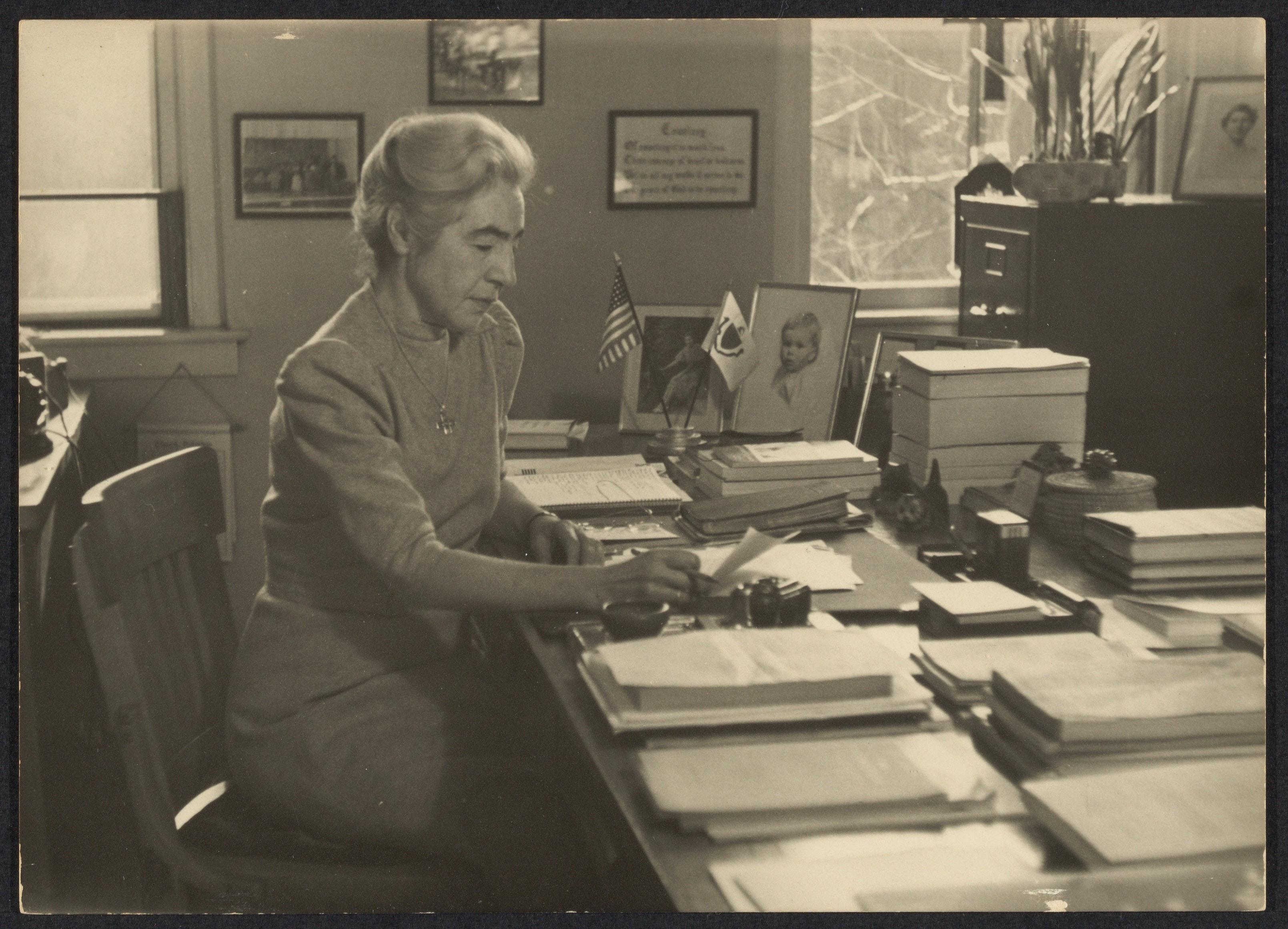 Miriam Van Waters sitting in her office.