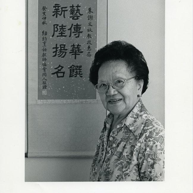 Portrait of Grace Zia Chu in front of a scroll